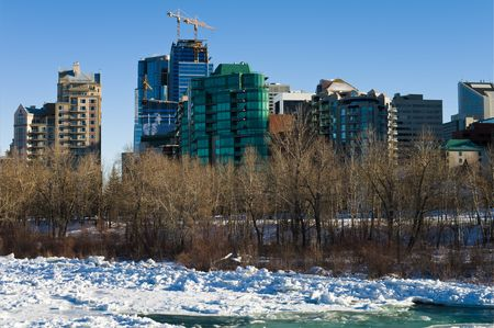 Construction of skyscrepers in Calgary winter time.  photo