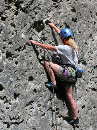 abseil: Woman rock climbing