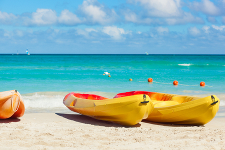 kayaks on the tropical beach with blue Atlantic sea in background. Cuba, Varadero