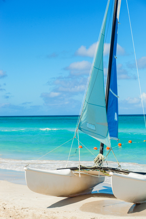 Catamaran landed on the beautiful beach of Varadero in Cuba with blueAtlantic ocean in background. Close up