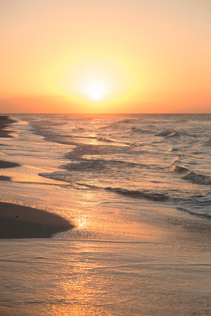 Beautiful tropical sunset on the Atlantic coast of Cuba. View of the ocean, waves and rays of the sun on the horizon. Evening at the beach Stock Photo