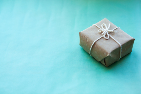 Present craft boxes with a bow on craft paper background. Pantone color. Minimalistic concept Stock Photo
