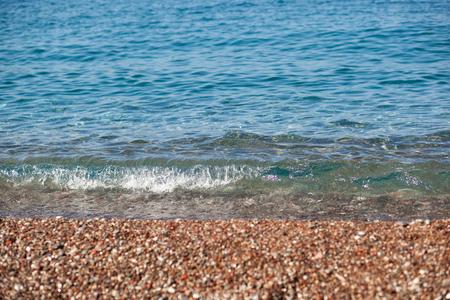 Stone beach of Budva riviera with waves and splashes