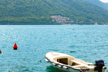 Adriatic sea view. Boat and montains on background. Travel concept