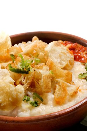 Chicken porridge made from rice and fill with chicken photo