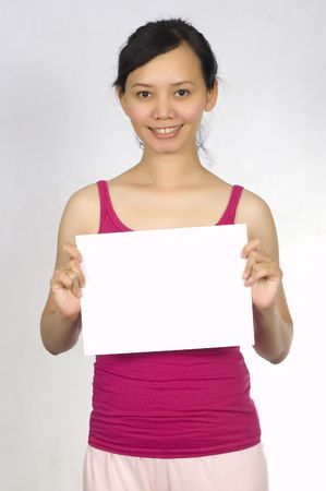 Beautiful Asian Model Holding Blank Sign, You Could Place Your Advertisement on this sheet photo