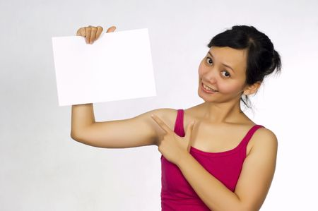 Beautiful Asian Model Holding Blank Sign, You Could Place Your Advertisement on this sheet Stock Photo - 5069151