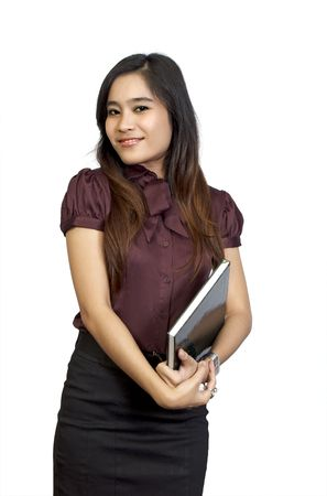 Beautiful college student holding book in her hand. She looks happy and intelligent photo