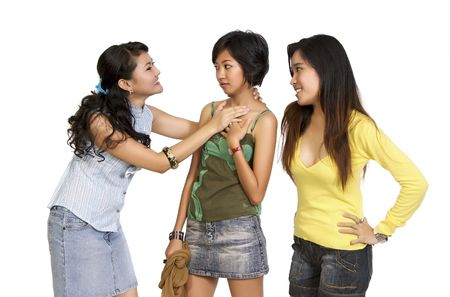mean: A Girl Got Bullying and intimidated by her two friends, in the white background Stock Photo