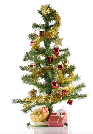 fake christmas tree: Decorated Fake christmas Tree full with ornament and gift over white background Stock Photo