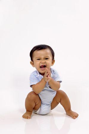 Baby girl sitting on white background, she looks cute Stock Photo - 6013831