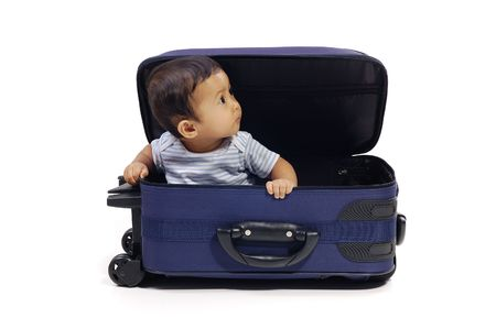 Baby girl in the blue suitcase on white background. Ready to travel Stock Photo - 6013844