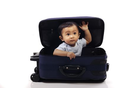 Baby girl in the blue suitcase on white background. Ready to travel Stock Photo - 6013832