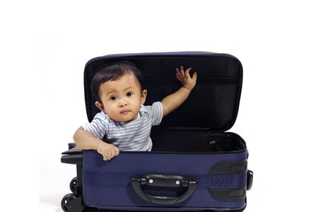 open suitcase: Baby girl in the blue suitcase on white background. Ready to travel