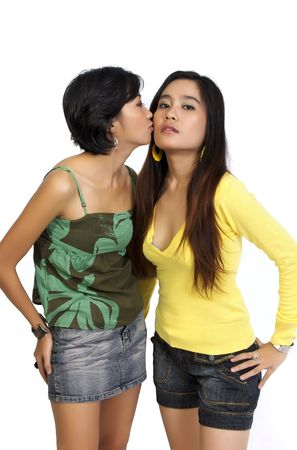 Two girls kissing on white background Stock Photo - 6036928