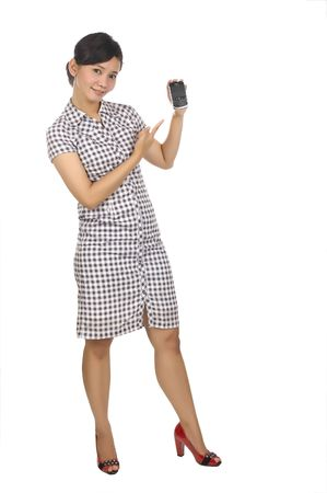 Full Body Portrait of Beautiful Asian Woman holding a cellphone isolated on white background photo