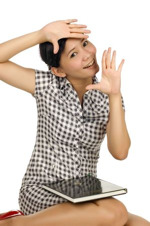 Brunette woman framing her face with her hand isolated on white background Stock Photo - 6469329