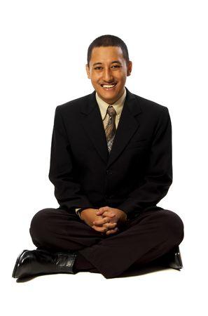 Business man meditating isolated on white background photo