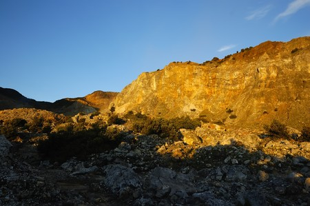 Morning sunrays on rocky cliff on mount papandayan, indonesia photo