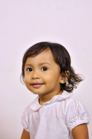 cute baby girl: Cute baby girl smiling, she looks adorable Stock Photo