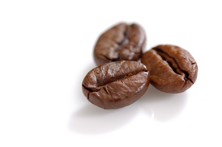 Three Roasted coffee beans shot in the studio