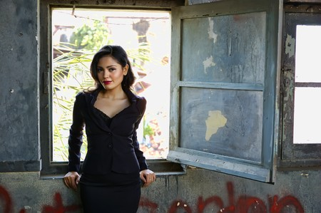 Pretty business woman wearing black suit, posing at outdoor photo