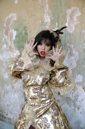 Chinese woman wearing victorian costume shoot at grunge building photo