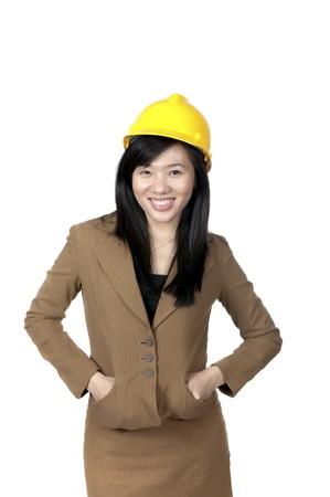 Female Engineer wearing yellow helmet isolated over white background photo