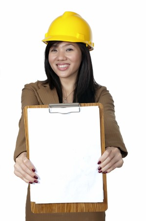 Female Engineer wearing yellow helmet show her paper board isolated over white background. You can put your text on the paper photo