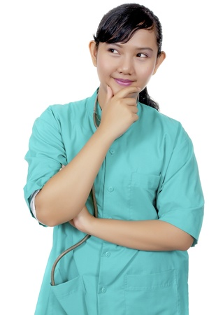 A Doctor wearing scrub isolated over white background photo