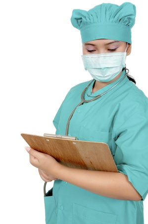 A Doctor wearing scrub and hold paperboard isolated over white background photo
