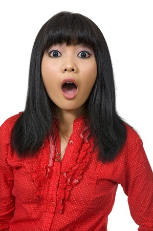 fear of failure: Asian woman surprised wearing red shirt and isolated over white background Stock Photo