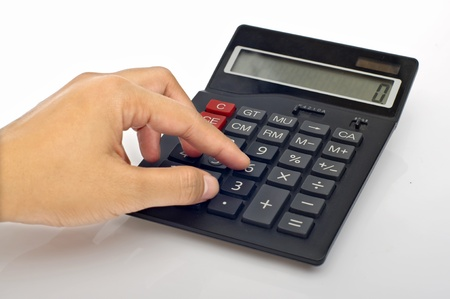 Woman hand push calculator button on the table photo