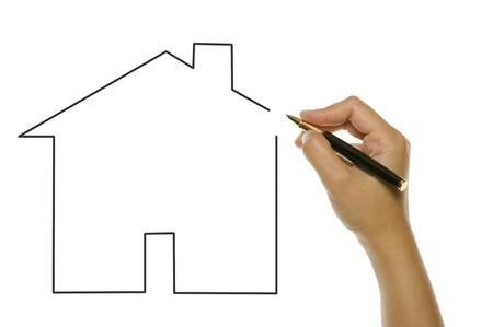 Woman hand draw with pen unfinished house isolated over white background photo