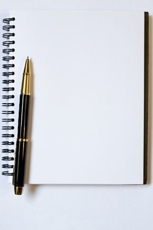 Blank notebook and pen, you can put your text in here photo