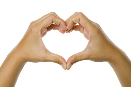 forming: Heart shaped from woman hand isolated over white background