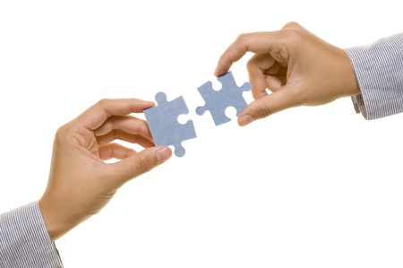 Hand and puzzle, isolated over white background photo