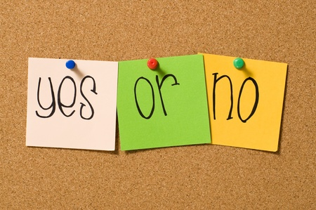 Yes or no question write on the paper on the cork board Stock Photo - 10313100