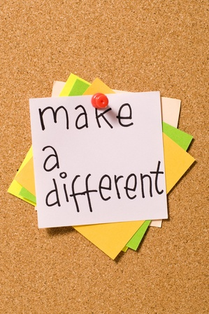 Make A Different write on the paper attached on the cork board Stock Photo - 10313098