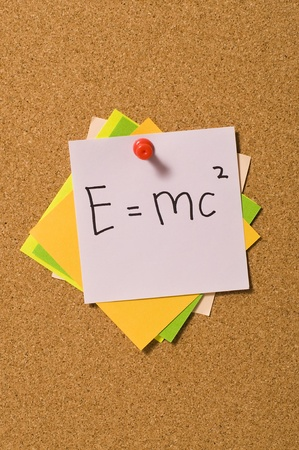 E=MC2 formula write on the paper attached on the cork board Stock Photo - 10313094