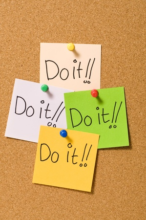 Do it writing on the paper attached on the cork board Stock Photo - 10313103