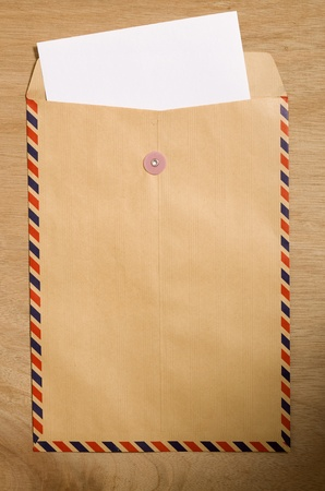 Brown envelope and paper. You can put your text on the paper photo