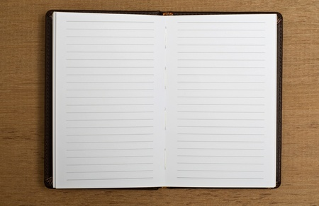 Open agenda with blank pages. You can put your text on the paper photo