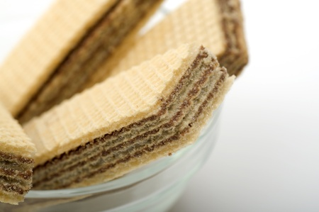 Chocolate Wafer in the glass bowl. over white background photo