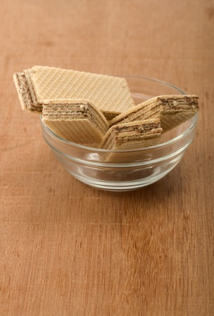 Chocolate wafer in the glass bowl. Shot on wooden background Stock Photo - 11171150