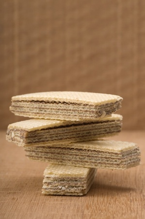 Chocolate wafer stacked and shot in the studio on wooden background photo