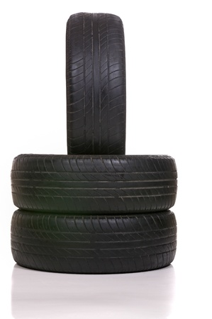 secondhand: Old tires stacked, isolated on white background