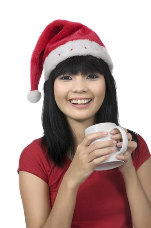 Beautiful asian woman celebrate christmas with drink hot coffee photo