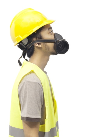 Worker wearing work gear looking up isolated over white background photo