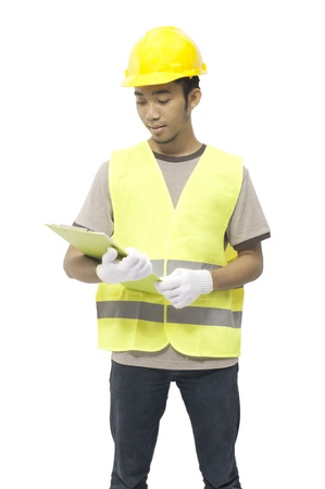 Young male worker hold clipboard isolated over white background photo